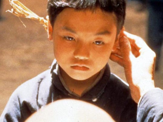 "Little ""Doggie"" (Renying Zhou) has been sold as a boy to get a better price but she isn't what she first appears because ""The King of Masks"" is a film about disguises. SUBMITTED"