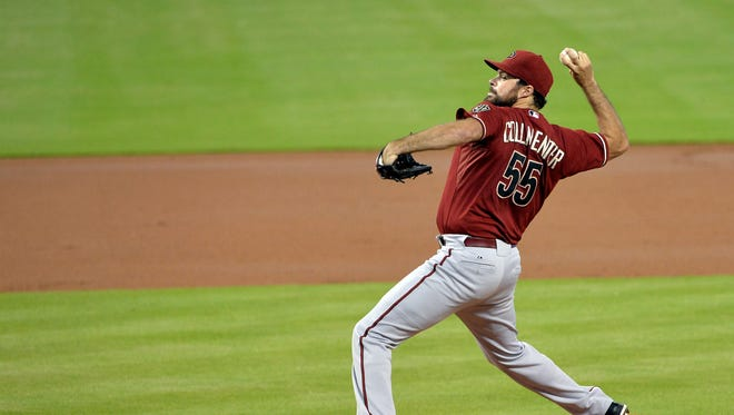 Aug 16, 2014: Arizona Diamondbacks starting pitcher Josh Collmenter (55) throws during the first inning against the Miami Marlins at Marlins Ballpark.