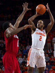 Clemson Tigers guard Marcquise Reed (2) shoots the ball while being defended by Louisville Cardinals forward V.J. King (0) during the second half at Littlejohn Coliseum in Clemson, South Carolina, on Saturday, Jan. 6, 2018.