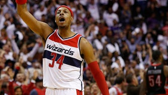 Apr 24, 2015; Washington, DC, USA; Washington Wizards forward Paul Pierce (34) and Wizards guard John Wall (2) celebrate on the court against the Toronto Raptors in the final minute of the fourth quarter in game three of the first round of the NBA Playoffs at Verizon Center. The Wizards won 106-99, and lead the series 3-0. Mandatory Credit: Geoff Burke-USA TODAY Sports ORG XMIT: USATSI-224312 ORIG FILE ID:  20150424_lbm_sv3_258.JPG