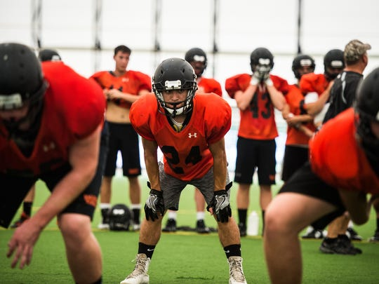 Eddie Cannon, middle, will be part of Palmyra's running back platoon this season.