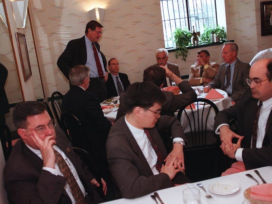 Richard Gardella (standing at left), president of the Westchester County Bar Association delivering a luncheon lecture on the subject of police chases and the Constitution at Ernesto's Restaurant in 1999.