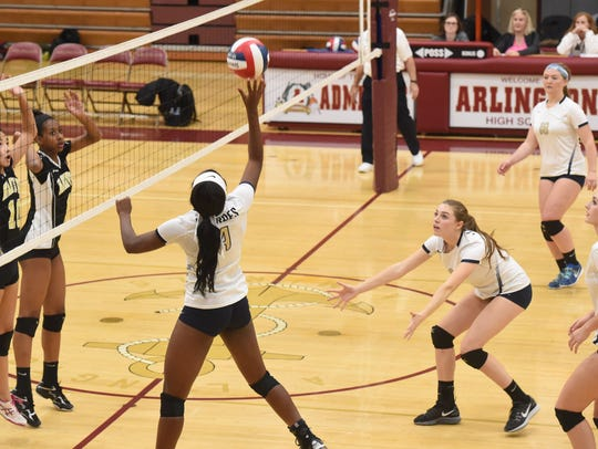 Lourdes' Rebecca Townes, center left, goes to tap the