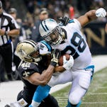 Dec 6, 2015; New Orleans, LA, USA; Carolina Panthers running back Jonathan Stewart (28) is tackled by New Orleans Saints linebacker James Anderson (42) during the second quarter at Mercedes-Benz Superdome. Mandatory Credit: Derick E. Hingle-USA TODAY Sports