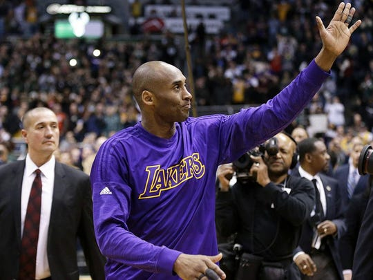 Kobe Bryant of the Lakers waves to the crowd at the at BMO Harris Bradley Center after the game against the Bucks on Monday.