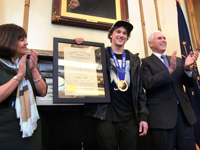 Indiana Governor Mike Pence presents a Distinguished Hoosier Award to Olympic Bronze Medalist Nick Goepper of Lawrenceburg in his Statehouse office in Indianapolis on Monday, March 3, 2014. Groepper won the bronze as the U.S. swept the medals in men's slopestyle skiing at the Winter Olympic Games in Sochi, Russia last month. At left is Indiana's First Lady Karen Pence.