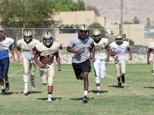 The Desert Hot Springs football team runs conditioning drills during practice August 9, 2016.