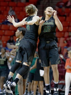 Baylor guards Kristy Wallace, left, and Alexis Prince celebrate during the second half of the Bears' win against Oklahoma in Norman, Okla.