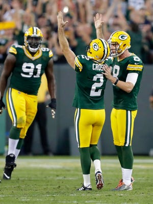 Green Bay Packers kicker Mason Crosby (2) and Justin Vogel (8) celebrate a game winning field goal in overtime against the Cincinnati Bengals on Sunday, September 10, 2017, at Lambeau Field in Green Bay, Wis.