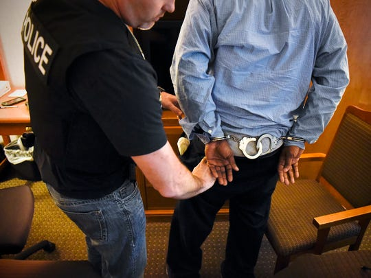 A Central Minnesota Sex Trafficking Task Force officer prepares to interview a man suspected of attempting to hire a prostitute during a sting operation Friday, June 3 at a St. Cloud hotel.
