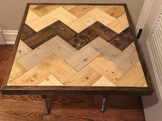 A table from DelleDonneDesigns is shown. Elena Delle Donne says the three partners in the furniture-making business use an app to help create the symmetrical designs.