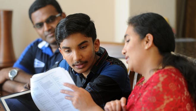 Rahul Naveen practices for the Scripps National Spelling Bee with his mother, Narmadha Naveen, and his father, Vijay Naveen, at their home in Simi Valley. Rahul is the Ventura County champion and will be competing at the national event.
