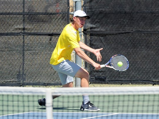Wylie's Zane McCurley hits a backhand during the Region