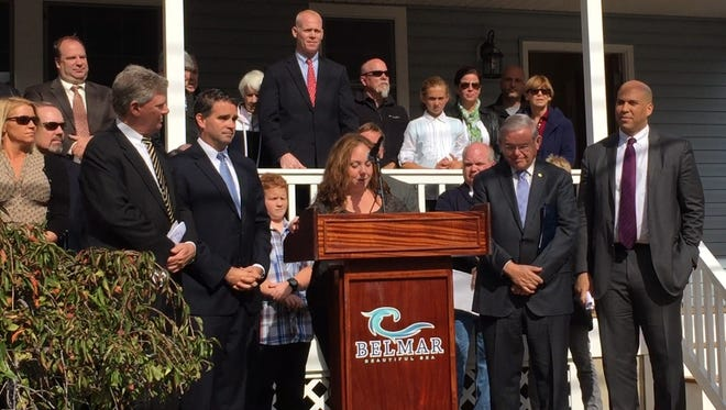 Teresa Keefe, center, talks about her family's journey after superstorm Sandy. U.S. Rep. Frank Pallone, Belmar Mayor Matt Doherty and U.S. Senators Robert Menendez and Cory Booker, all Democrats, all made remarks during a news conference at her new home Monday.
