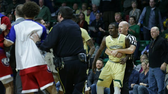 Referee Kipp Kissinger holds back UAB Blazers guard Hakeem Baxter (0) during a fight which involved almost all of both benches during the second half at Bartow Arena.