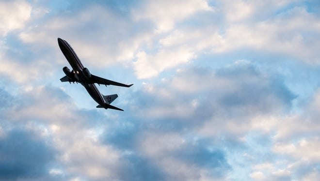A plane takes off from Washington's Ronald Reagan National Airport early in the morning.