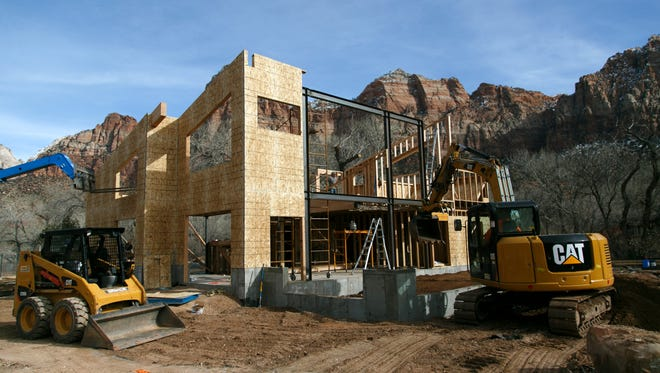 Construction work continues on the new 5500 square foot home of Zion Outfitters in Springdale's Zion Canyon Village just outside the entrance to Zion National Park, Tuesday, Jan. 19, 2016.