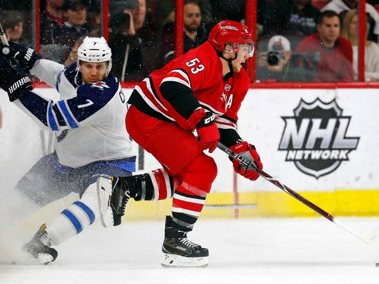 Carolina Hurricanes' Jeff Skinner (53) sidesteps a hit from Winnipeg Jets' Ben Chiarot (7) during the first period of an NHL hockey game, Sunday, March 4, 2018, in Raleigh, N.C. (AP Photo/Karl B DeBlaker)