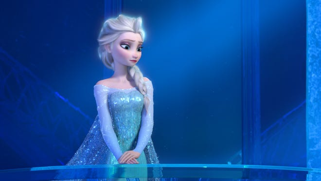 """This image released by Disney shows a teenage Elsa the Snow Queen in a scene from the animated feature """"Frozen."""""""