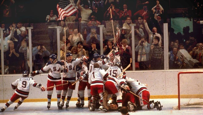 In this Feb. 22, 1980 file photo, the U.S. hockey team pounces on goalie Jim Craig after a 4-3 victory against the Soviets in the 1980 Olympics, as a flag waves from the partisan Lake Placid, N.Y. crowd. It's been more than three decades since his landmark goal became the centerpiece of the U.S. Olympic hockey team's Miracle on Ice. For 60-year-old Mike Eruzione, it still seems like only yesterday.