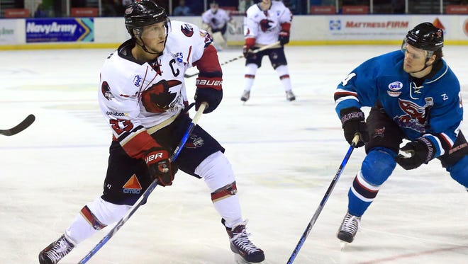 IceRays' Mason Krueger passes the puck against Shreveport during the first period on Wednesday, April 19, 2017, at the American Bank Center in Corpus Christi.