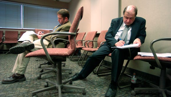 David Kranz (right) takes notes as Hillary Clinton