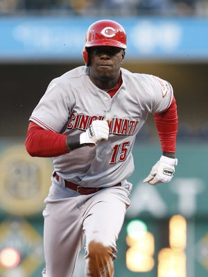 Cincinnati Reds left fielder Roger Bernadina (15) runs from second to third base after an errant throw by the Pittsburgh Pirates during the second inning at PNC Park.