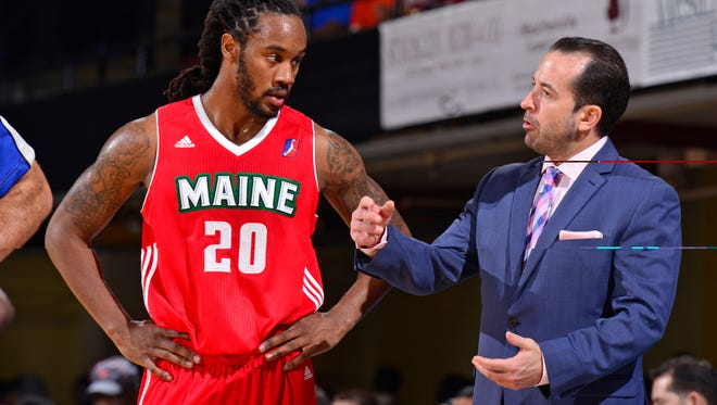 Levi Randolph #20 and Scott Morrison of the Maine Red Claws talk during a recent game.