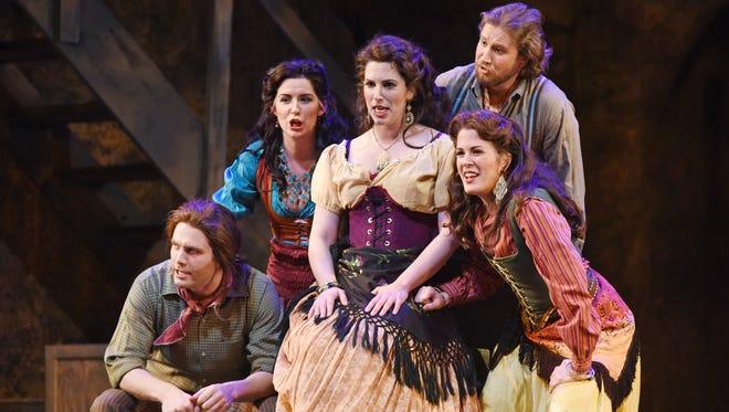 "In Arizona Opera's ""Carmen,"" Joseph Lattanzi plays ""El Dancairo"", Alyssa Martin is ""Mercedes"", Beth Lytwynec plays ""Carmen"", Andrew Penning is ""El Remendado"" and Amy Mahoney is ""Frasquita."""