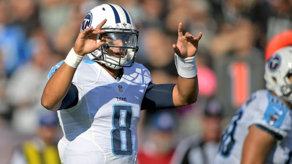 Aug 27, 2016; Oakland, CA, USA; Tennessee Titans quarterback Marcus Mariota (8) signals from the line against the Oakland Raiders during the first half at Oakland-Alameda Coliseum. Mandatory Credit: Kirby Lee-USA TODAY Sports