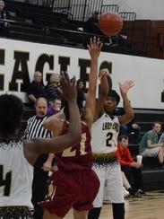Abilene High's Trakenya Roberson shoots a 3-pointer