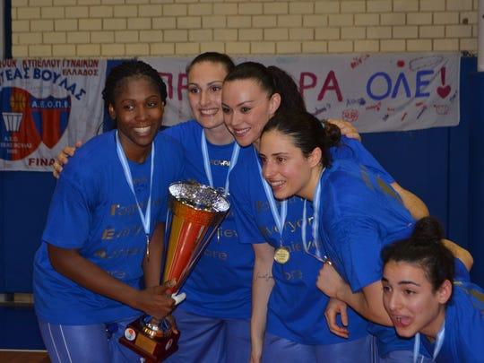 Lykendra Johnson, left, and her AE Ellinikou teammates celebrate after winning the Greek League championship in 2014.