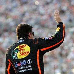 Tony Stewart, driver of the #14 Bass Pro Shops / Mobil 1 Chevrolet, waves to the crowd prior to the NASCAR Sprint Cup Series Oral-B USA 500 at Atlanta Motor Speedway on August 31, 2014 in Hampton, Georgia.