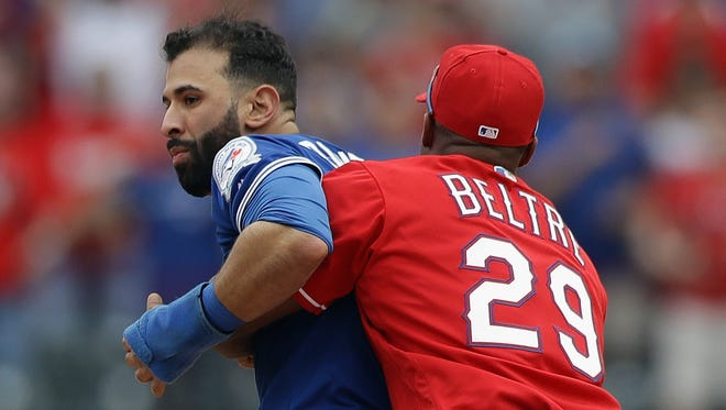 Adrian Beltre restrains Jose Bautista during Sunday's altercation.