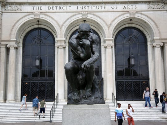The Thinker by Auguste Rodin in front of the Detroit
