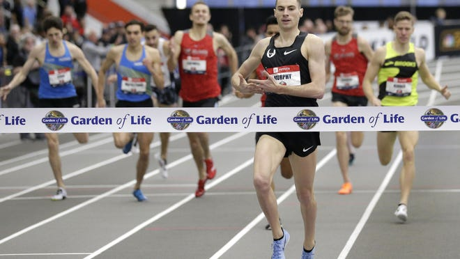 Clayton Murphy crosses the finish line first during the men's 1000 meter race at the USA Track & Field Indoor Championships in New York on Feb. 24, 2019.