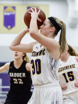 Oconomowoc sophomore Caitlin McArthey (30) takes aim from the corner during the Division 1 playoff game at home against Badger on Friday, Feb. 23.