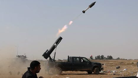 Iraqi security forces launch a rocket against Islamic State positions during clashes in Tikrit, about 80 miles north of Baghdad, Iraq, on Monday, March 30, 2015. Fighting moved into the streets of downtown on Tuesday.