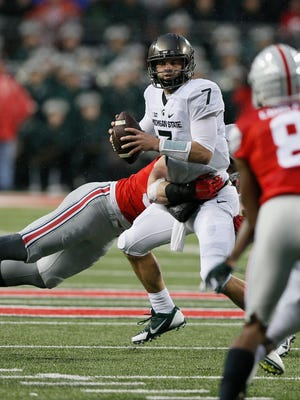 Filling in for injured Connor Cook, Tyler O'Connor led Michigan State to a 17-14 upset of Ohio State on Saturday, November 21, 2015, in Columbus, Ohio.