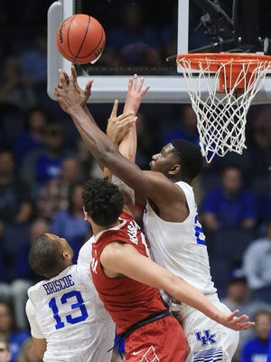 Kentucky's Alex Poythress reaches for a rebound Friday.