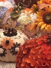 Pumpkins decorated by Carol De Santis-Muñoz.