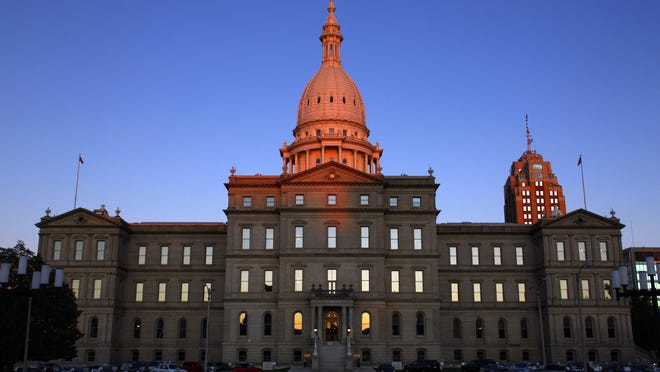 In this Sept. 30, 2009 file photo, sunlight strikes the dome of the state Capitol building.