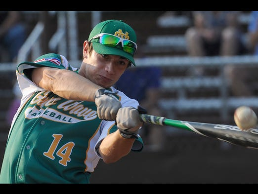Newark Catholic alumnus Hunter Nance hits one out of the park during the Home Run Derby on Friday, August 1, 2014, at Heath High School.