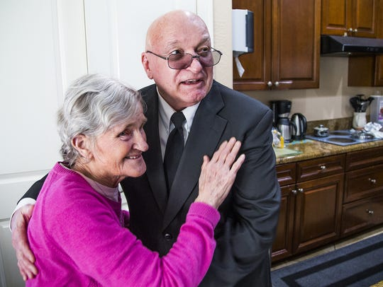 Bob McGuire visits his wife, Linda, at an adult care