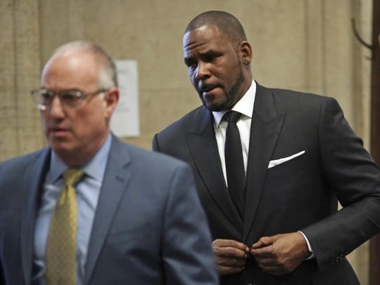 R&B singer R. Kelly, right, appears in court with his