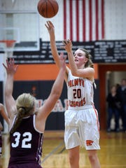 Palmyra's Molly Gundermann sends the Cougars into overtime Tuesday against Mechanicsburg with a game-tying 3-pointer. Palmyra went on to win, 33-29.