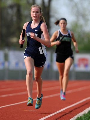 Granville's Reilly Zink runs the anchor leg of the 4x1,600 relay this past Friday during the Fulton Relays at Lancaster.