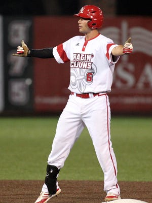 UL's Nick Thurman gestures back to his teammates after hitting a double against Northwestern State in 2015 at The Tigue.