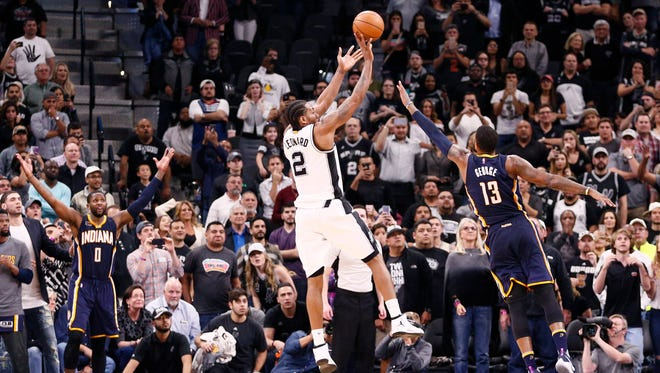 San Antonio Spurs small forward Kawhi Leonard (2) makes the game winning basket over Indiana Pacers small forward Paul George (13) during the second half at AT&T Center. The Spurs won 100-99.