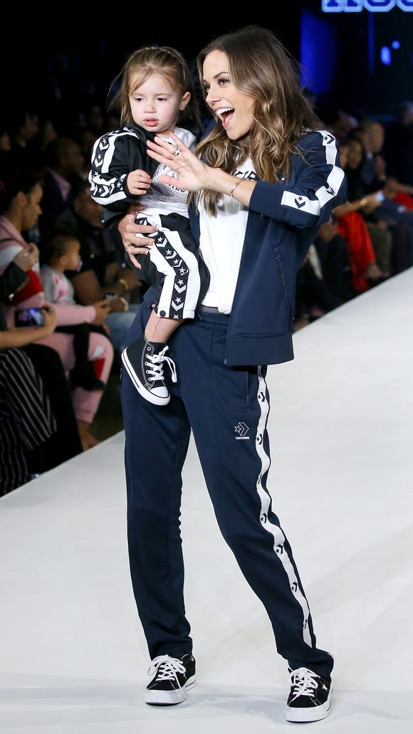 Jana Kramer walks the runway with her daughter, Jolie Rae Caussin, during the 2018 Rookie USA Show held at Milk Studios on Feb. 15, 2018, in Los Angeles.